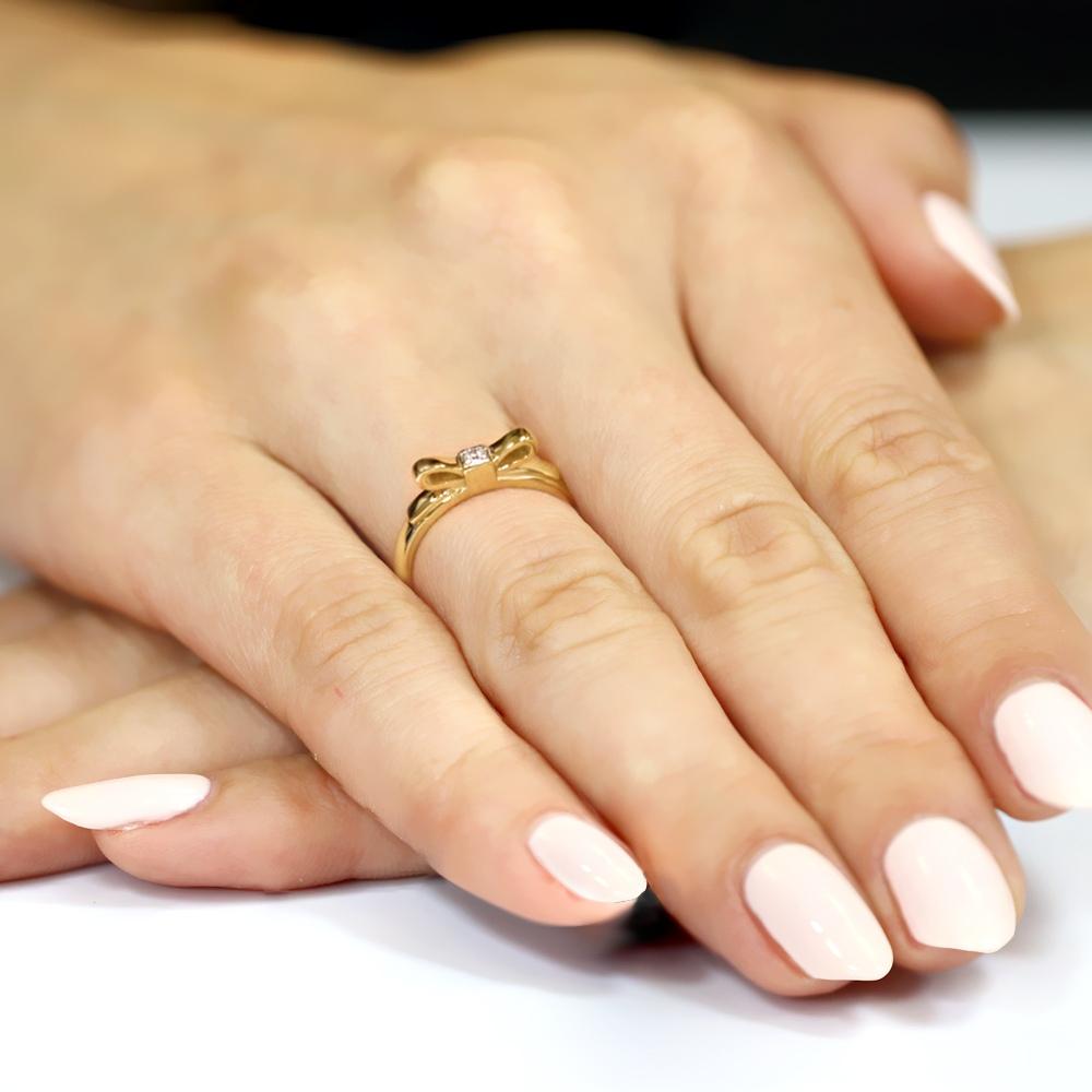 Pierścionek zaręczynowy 585 złoto z brylantem kokadrka 0,03ct